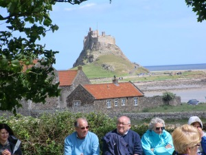 Lindisfarne Castle with pilgrims waiting for Mass to start.