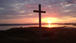The setting sun over St. Cuthbert's Island, Lindisfarne.