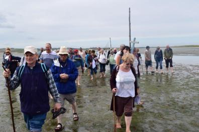pilgrims-in-their-stride-as-they-cross-the-causeway